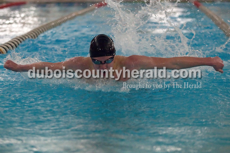 Heritage Hills' Christian Motteler swam in the individual boys 100 yard butterfly during Monday night's swim meet against Heritage Hills in Huntingburg. Rachel Mummey/The Herald