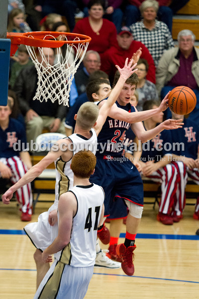 Heritage Hills' Tyler Ward passed the ball as he jumped during Monday night's PSC Holiday Classic championship against Corydon Central in Reo. The Patriots lost 72-58. Ariana van den Akker/The Herald