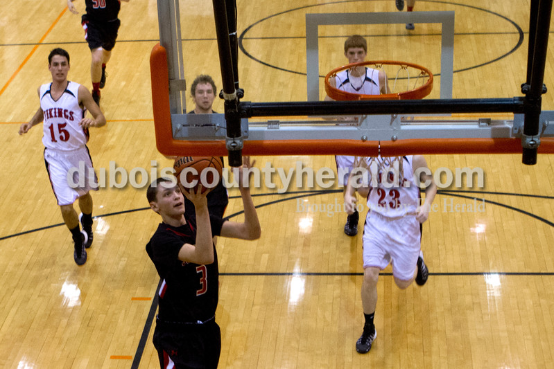 Sourthridge's Evan Julian made a layup during Saturday evening's fifth-place game against North Posey at the Graber Post Buildings Classic at North Daviess High School.  Southridge won 56-41.  Ariana van den Akker/The Herald