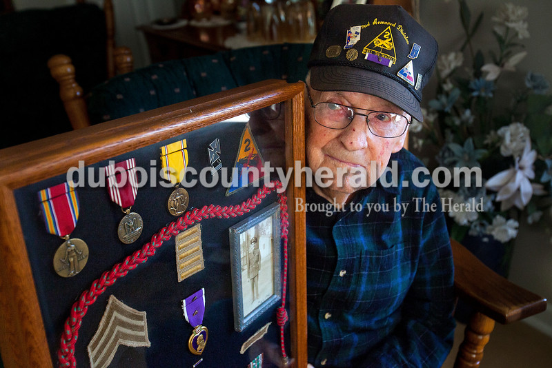 Rachel Mummey/The Herald<br /> World War II veteran Glen Brittian of Jasper received two purple hearts during his tour of duty throughout western Europe, one of which he keeps in a display case while the other he keeps pinned to his hat.