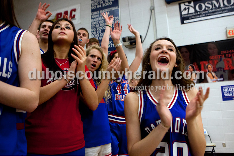 Heritage Hills senior Peyton Hufnagel, left, and juniors Sienna Crews and Madison Fella cheered after the Patriots scored during Monday night's PSC Holiday Classic championship against Corydon Central in Reo. The Patriots lost 72-58. Ariana van den Akker/The Herald