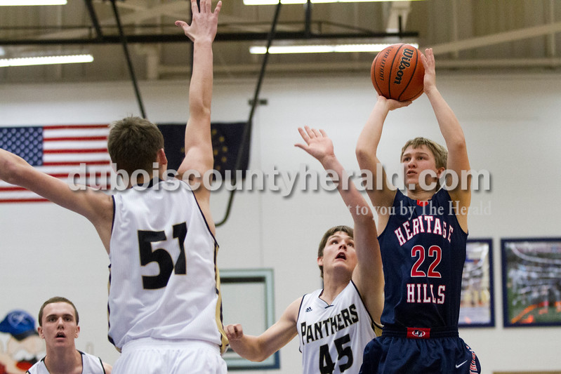 Heritage Hills' Zach Zolgman shot the ball as Corydon Central's Dillion Simler guarded him during Monday night's PSC Holiday Classic championship in Reo. The Patriots lost 72-58. Ariana van den Akker/The Herald