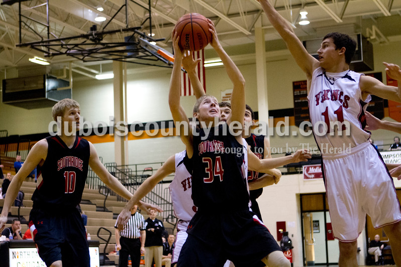 Southridge's Cam O'Bryan shot the ball as North Posey's James Marshall tried to block during Saturday evening's fifth-place game at the Graber Post Buildings Classic at North Daviess High School.  Southridge won 56-41.  Ariana van den Akker/The Herald