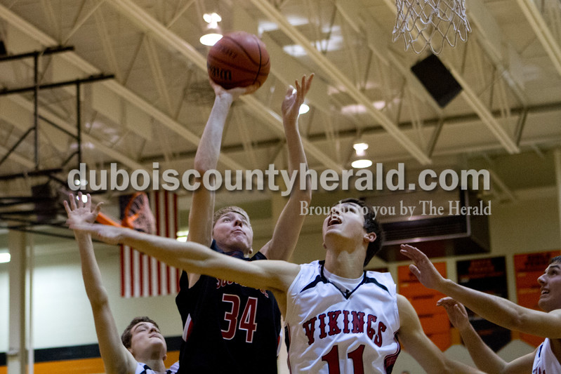Southridge's Cam O'Bryan shot the ball as North Posey's James Marshall tried to defend during Saturday evening's fifth-place game at the Graber Post Buildings Classic at North Daviess High School.  Southridge won 56-41.  Ariana van den Akker/The Herald