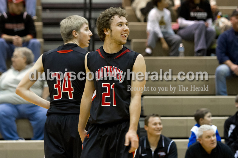 Southridge's Connor Craig smiled after a score as he and Cam O'Bryan walked across the court during Saturday evening's fifth-place game against North Posey at the Graber Post Buildings Classic at North Daviess High School.  Southridge won 56-41.  Ariana van den Akker/The Herald