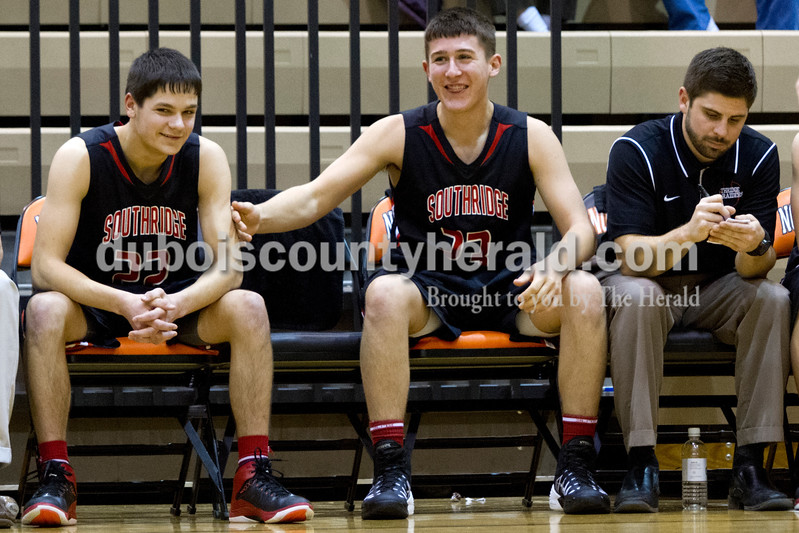 Southridge's Corbin Neu, left, and Payton Mattingly joked around while coach Matt Block took stats on the bench during Saturday evening's fifth-place game against North Posey at the Graber Post Buildings Classic at North Daviess High School.  Southridge won 56-41.  Ariana van den Akker/The Herald