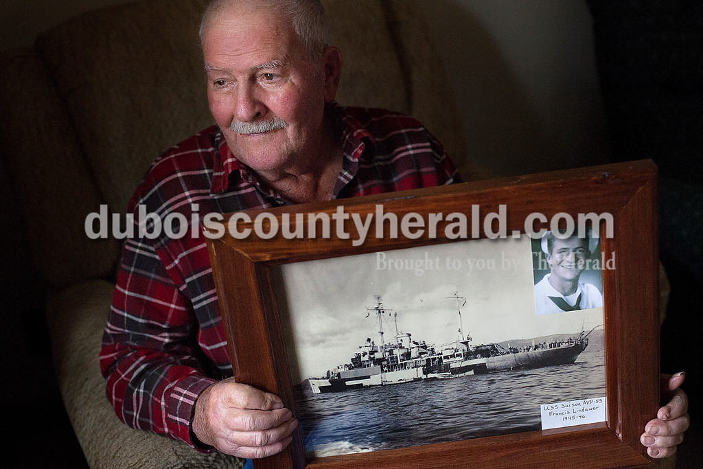 Rachel Mummey/The Herald<br /> Francis Lindauer of Ferdinand held a photograph of the USS Suison where he was was assigned with the Navy as an engine mechanic during WWII. Earlier this year in September, Lindauer was the youngest of seventy veterans invited to participate in an Indy Honor Flight to visit Washington D.C.