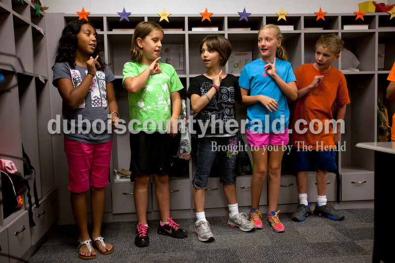 Chloe's classmates Chanté Miller, left, Samantha Truelove, Kylie Morton and Eric Ehrhard looked to Chloe for guidance as they signed the Pledge of Allegiance at the beginning of the day at Dubois Elementary School on Sept. 4. Ariana van den Akker/The Herald