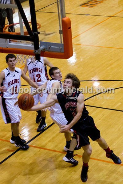 Southridge's Connor Craig shot the ball during Saturday evening's fifth-place game against North Posey at the Graber Post Buildings Classic at North Daviess High School.  Southridge won 56-41.  Ariana van den Akker/The Herald