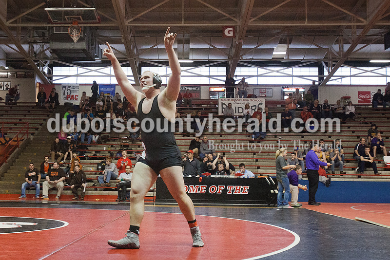 Southridge's Alex Merkel turned toward the crowd after defeating Jasper's Carson Popp during Saturday's wrestling sectional at Memorial Gym in Huntingburg. Rachel Mummey/The Herald