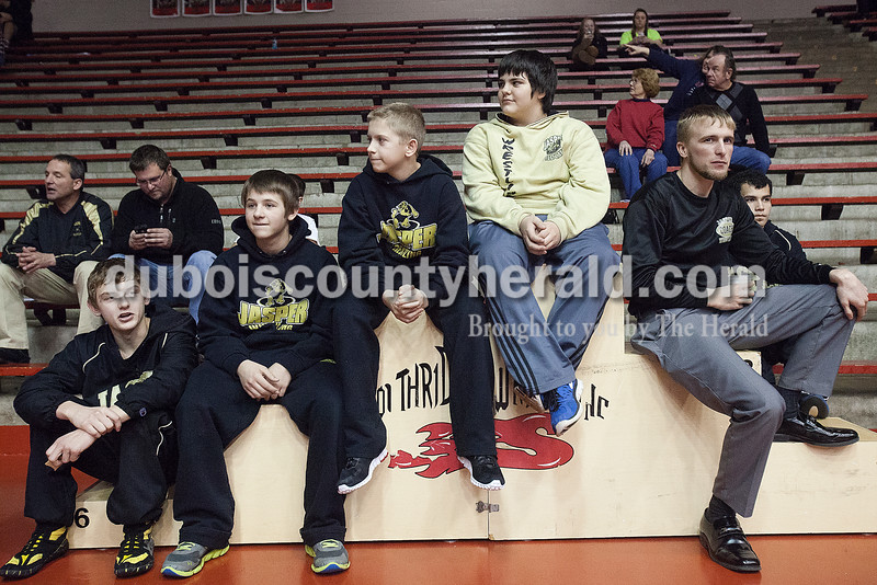 Jasper's Geordon Terwiske, left, Justin Rottet, Austin Hildenbrand,<br />  Logan Smith, and coach Sean Brescher hung out between rounds during Saturday's wrestling sectional at Memorial Gym in Huntingburg. Rachel Mummey/The Herald