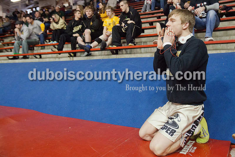 Jasper's Ruger Kerstiens cheered on one of his teammates during Saturday's wrestling sectional at Memorial Gym in Huntingburg. Rachel Mummey/The Herald