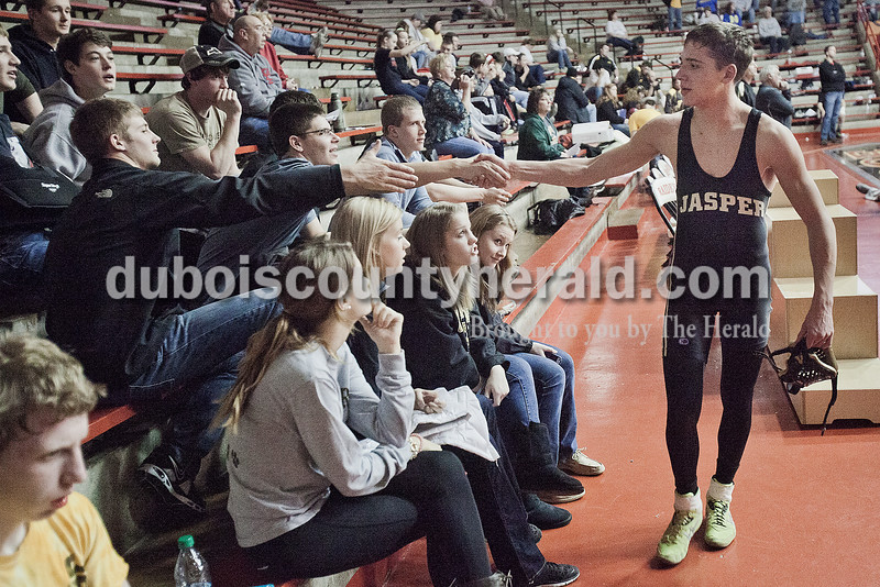 Jasper's Nathan Schitter received congratulations from friends after winning the 126-pound championship bout during Saturday's wrestling sectional at Memorial Gym in Huntingburg. Rachel Mummey/The Herald