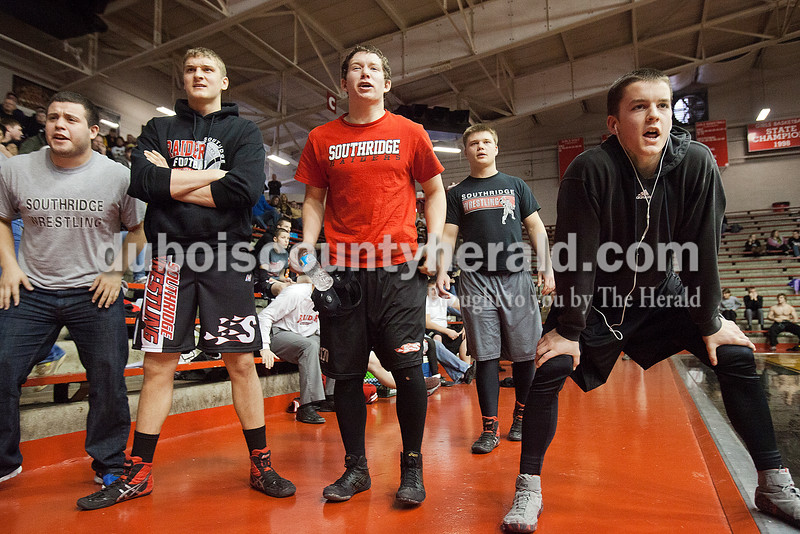 Southridge's Javi Canales, left,  Andy Fischer, Bryce Harter, Aidan Michel, and Jacob Mundy cheered on one of his teammates during Saturday's wrestling sectional at Memorial Gym in Huntingburg. Rachel Mummey/The Herald
