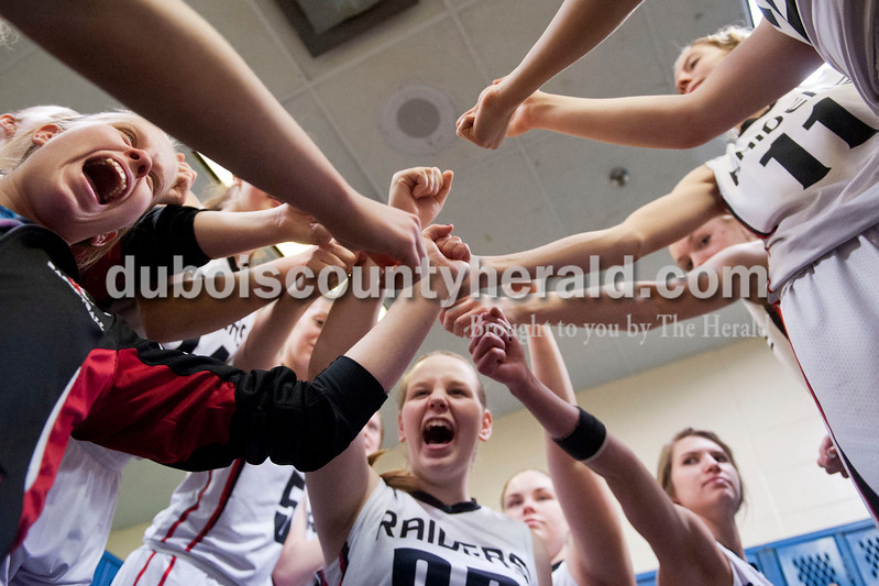 Carolyn Van Houten/The Herald<br /> The Raiders huddled and cheered in the locker room after winning the Class 3A girls basketball sectional championship at Alice Arena in Vincennes on Saturday.  Southridge defeated Vincennes 46-41.