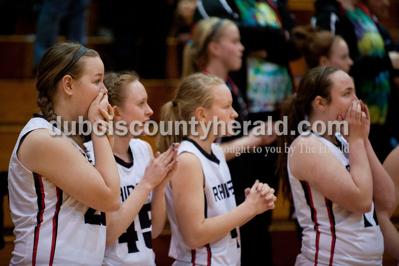 Carolyn Van Houten/The Herald<br /> Southridge's Lindsey Schaeffer, left, Emily Eckert, Sidney Eckert and Brianna Lammers reacted as they realized the Raiders won the Class 3A girls basketball sectional championship at Alice Arena in Vincennes on Saturday.  Southridge defeated Vincennes 46-41.