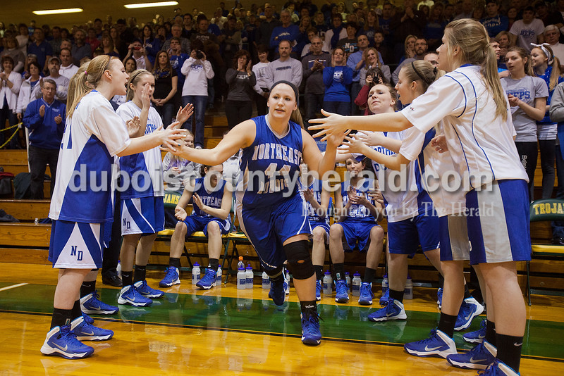 Northeast Dubois' Morgan Seng received high fives from her teammates at the start of Saturday's Class 1A sectional championship against Wood Memorial in Oakland City. Northeast Dubois lost in overtime 62-57. Rachel Mummey/The Herald