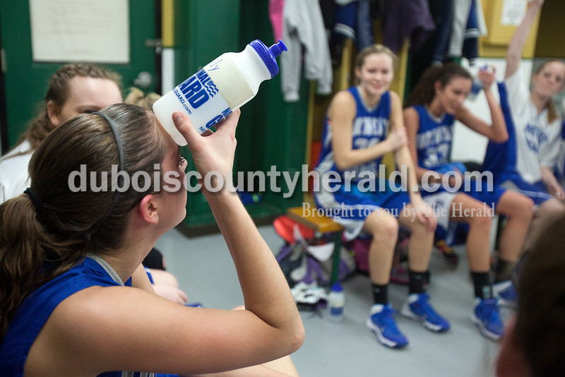 Northeast Dubois' Emily Leuken cooled off during half time of Saturday's Class 1A sectional championship against Wood Memorial in Oakland City. Northeast Dubois lost in overtime 62-57. Rachel Mummey/The Herald