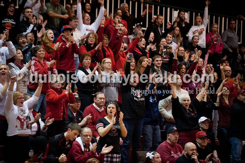 Carolyn Van Houten/The Herald<br /> Southridge fans cheered as the clock ran out at the end of the Class 3A girls basketball sectional championship at Alice Arena in Vincennes on Saturday.  Southridge defeated Vincennes 46-41.
