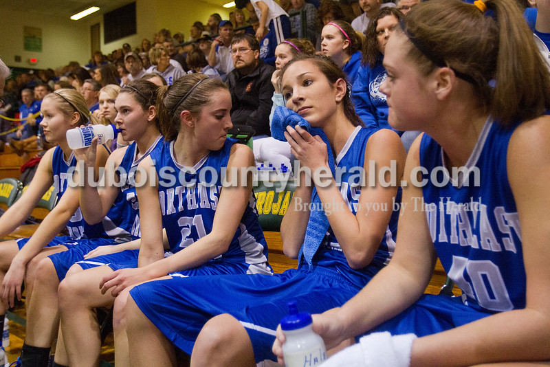 Northeast Dubois' Katelyn Helming, left, Brynn Hoffman, Emily Lueken, Rachel Breitwieser and Haley Kinder gathered in a time out during Saturday's Class 1A sectional championship against Wood Memorial in Oakland City. Northeast Dubois lost in overtime 62-57. Rachel Mummey/The Herald