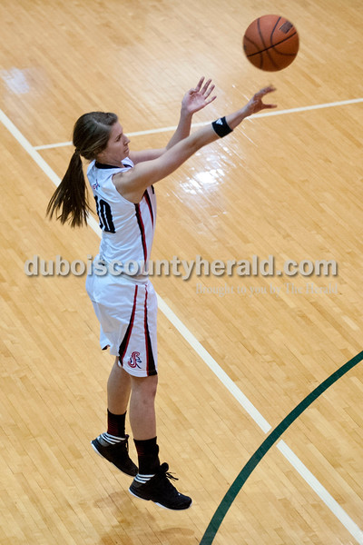 Carolyn Van Houten/The Herald<br /> Southridge's Kadie Dearing shot the ball during the Class 3A girls basketball sectional championship at Alice Arena in Vincennes on Saturday.  Southridge defeated Vincennes 46-41.