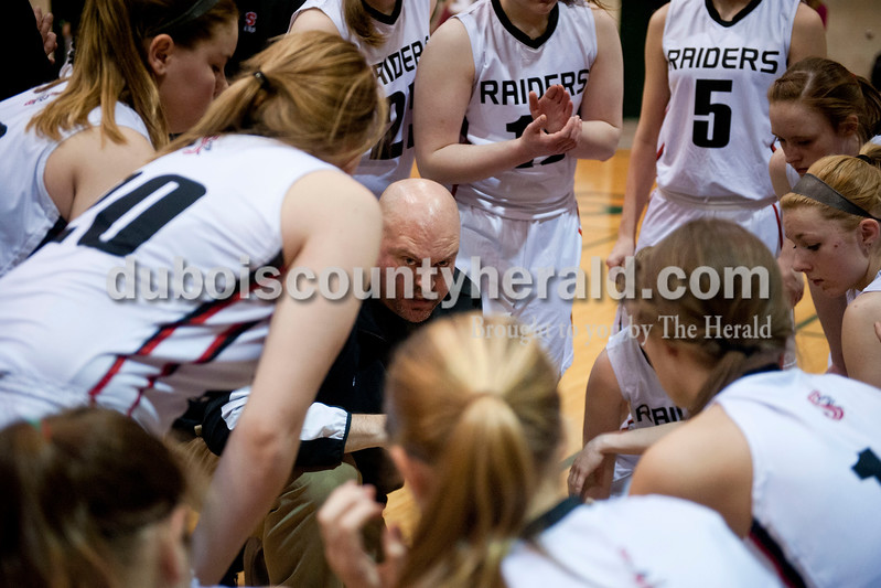 Carolyn Van Houten/The Herald<br /> Southridge's Head Coach Greg Werner spoke to his team during the Class 3A girls basketball sectional championship at Alice Arena in Vincennes on Saturday.  Southridge defeated Vincennes 46-41.