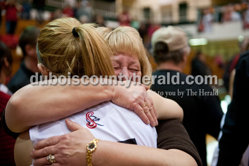 Carolyn Van Houten/The Herald<br /> Southridge's Taylor Neukam hugged her aunt, Debbie Roach of Huntingburg, after the Raiders won the Class 3A girls basketball sectional championship at Alice Arena in Vincennes on Saturday.  Southridge defeated Vincennes 46-41.