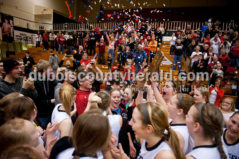Carolyn Van Houten/The Herald<br /> The Southridge Raiders hoisted their trophy up as fans gathered around them after they won the Class 3A girls basketball sectional championship at Alice Arena in Vincennes on Saturday.  Southridge defeated Vincennes 46-41.