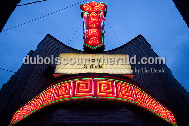 Rachel Mummey/The Herald<br /> The Astra Theatre marquee signs lit the for sale sign on the Jasper Square on Tuesday evening. The theater, built in 1937 by Joseph Gutzweiler and closed in 2002.