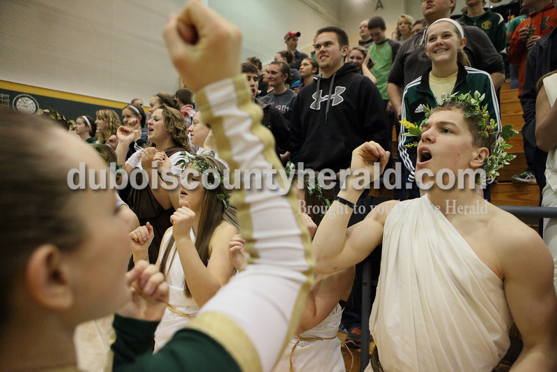 Heather Rousseau/The Herald<br /> Forest Park sophomore Cheerleader Payton Prechtel, of Bretsville, left,  encouraged students, to cheer, front row from left, juniors Madison Knies and Katelyn Roos, and senior Bryce Bettag. Behind from left, seniors,Cole Wendholt and Shelby Louden, all of Ferdinand. The Forest Park boys were competing against Gibson Southern Tuesday night's in Ferdinand. The Rangers won 56-36.