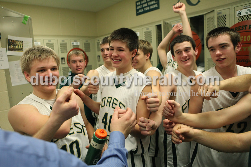 Heather Rousseau/The Herald<br /> Forest Park's team huddled with coach Jeff Litherland after winning Tuesday night's game against Gibson Southern in Ferdinand. The Rangers won 56-36.