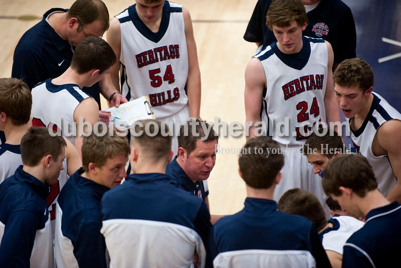 Carolyn Van Houten/The Herald<br /> Heritage Hills' Head Coach Matt Sisley spoke to his team during the game in Lincoln City on Tuesday.  Heritage Hills defeated Princeton 59-58 in their last home game of the season.