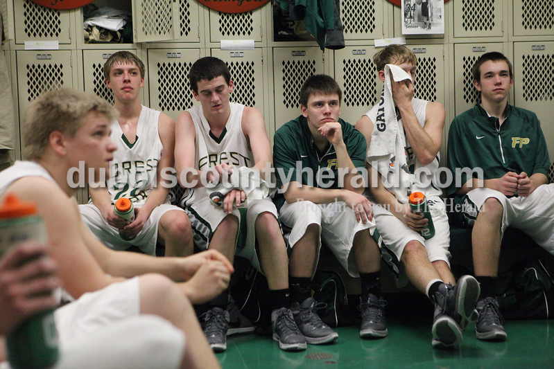Heather Rousseau/The Herald<br /> The Forest Park boys team listened to coach Jeff Litherland during half-time of Tuesday night's game against Gibson Southern in Ferdinand. The Rangers won 56-36.