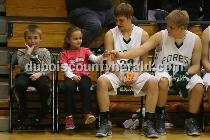 Heather Rousseau/The Herald<br /> Forest Park's Joel Weyer, right, fist bumped with Mayci Litherland, 7, the head coach's daughter, as Forest Park's Damon Wilmes watched and Gavin Winkler, the junior varsity coach's son, watchedTuesday night's game in Ferdinand against Southern Gibson. The Rangers won 56-36.