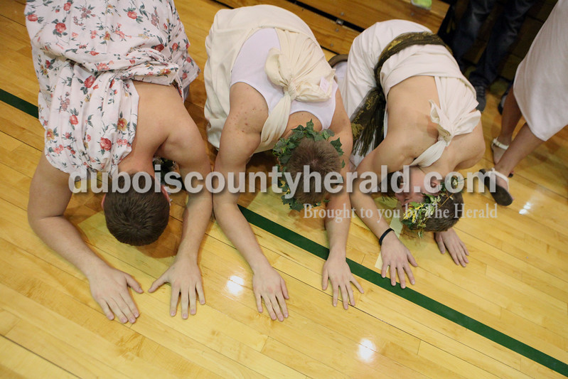 Heather Rousseau/The Herald<br /> Forest Park seniors, Blake Altmann, left, Reece Heilers, and Bryce Bettag all of Ferdinand, bowed down on the gym floor as the boys basketball team was introduced during senior night and the home game against Gibson Southern on Tuesday. The Rangers won 56-36.