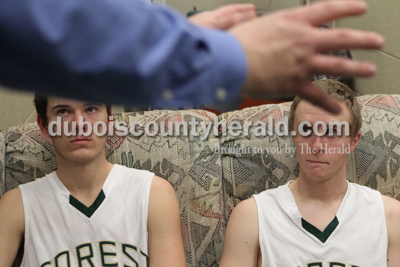 Heather Rousseau/The Herald<br /> Forest Park's Dakota Begle, left, and Jaxon Cronin listened to coach Jeff Litherland  during half-time of Tuesday night's game against Gibson Southern in Ferdinand. The Rangers won 56-36.