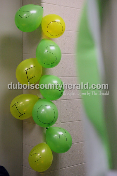 """Heather Rousseau/The Herald<br /> Balloons that spell out """"GO SENIORS"""" decorated the boys locker room at Forest Park during Tuesday night's game against Gibson Southern in Ferdinand. The Rangers won 56-36"""