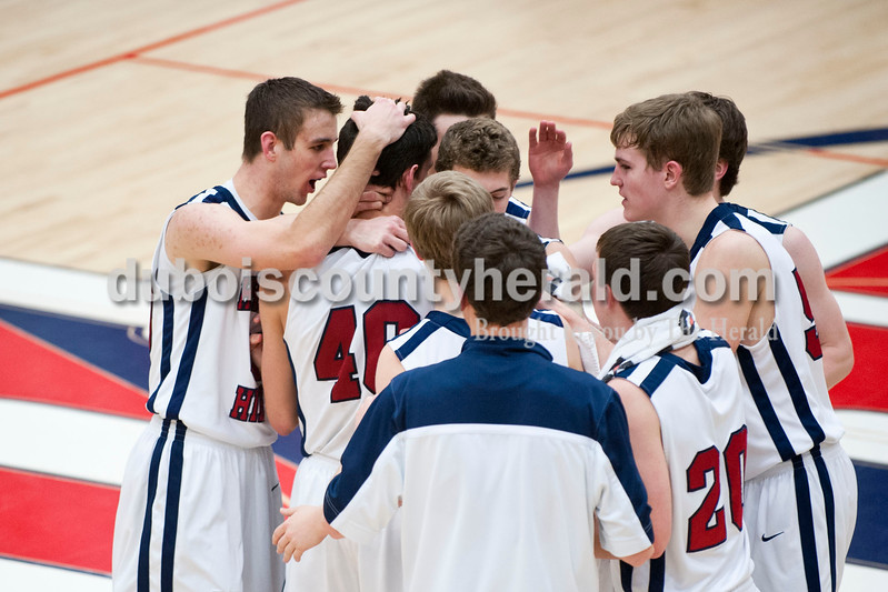 Carolyn Van Houten/The Herald<br /> Heritage Hills' team celebrated mid-court because Devon Merder scored his one-thousandth point during the game in Lincoln City on Tuesday.  Heritage Hills defeated Princeton 59-58 in their last home game of the season.