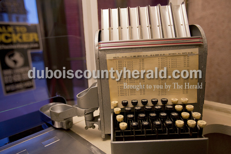 Rachel Mummey/The Herald<br /> The antique coin machine at Astra Theatre sat unused in Jasper on Tuesday evening. The theater, built in 1937 by Joseph Gutzweiler and closed in 2002.