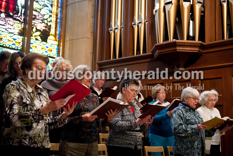 Carolyn Van Houten/The Herald<br /> Joan Jarboe, 88, far right, sang with the adult choir during mass at St. Joseph's Church in Jasper on Sunday.  Her son Brent Jarboe also sings in the adult choir and her granddaughter Grace Jarboe, 8, and great grandson Thomas Gilbert, 8, sing in the children's choir.  Together they make up four generations of choir singers at St. Joseph's church.  All are of Jasper.
