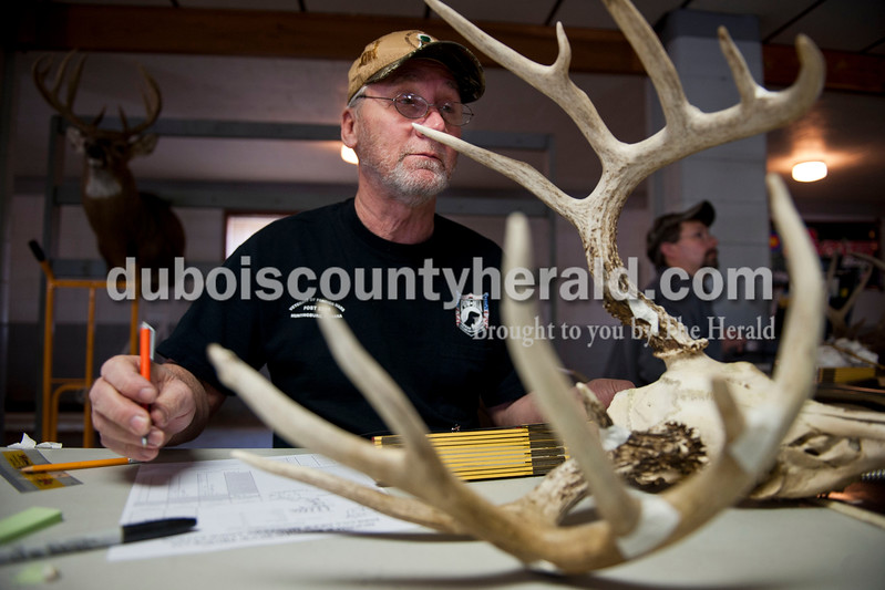 Carolyn Van Houten/The Herald<br /> Mark Jackson of Jasper measured antlers for the Hoosier Record Buck Program during the 3rd annual 3D Archery Match at the St. Anthony Conservation Club on Saturday.  Shooters had to shoot 30 targets set out along the trails in order to compete for trophies.
