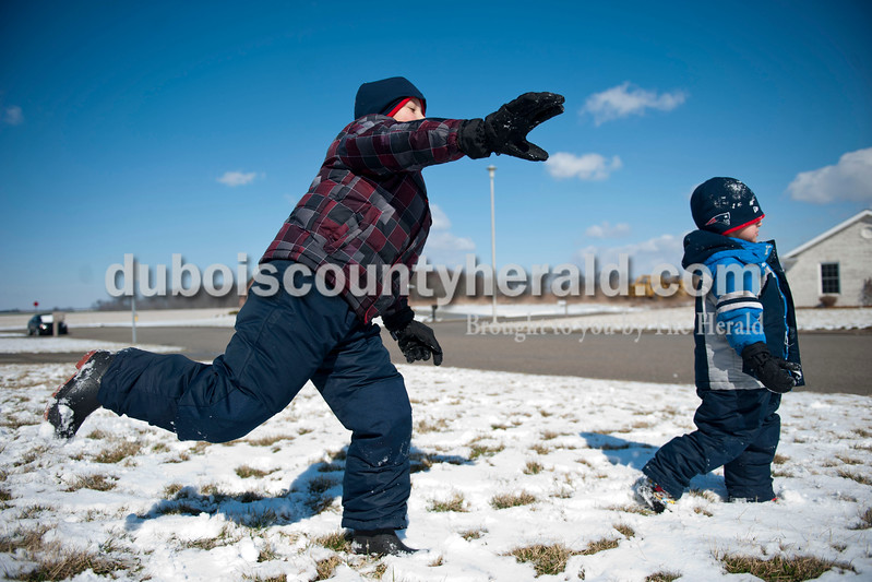 "Carolyn Van Houten/The Herald<br /> Alex Bastien, 7, left, threw a snowball past his brother Holden Bastien, 4, outside of their home in Jasper on Tuesday.  ""We like to play in the snow a lot, but we don't always get to play in it so this is fun,"" Alex said.  ""The wind makes it really cold though."""