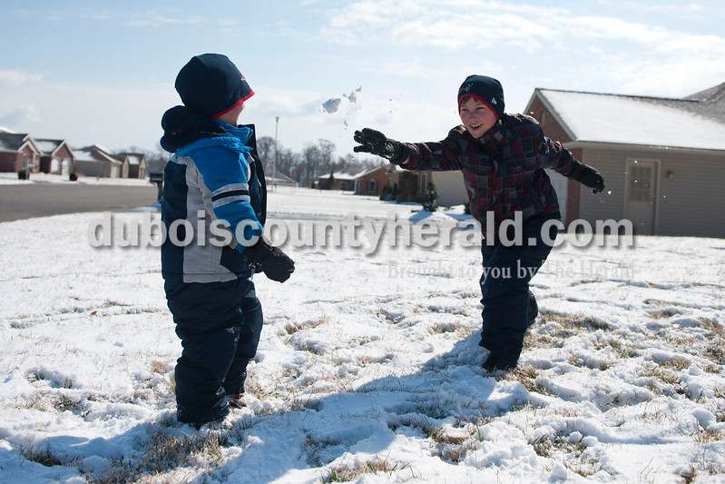 "Carolyn Van Houten/The Herald<br /> Alex Bastien, 7, right, threw a snowball at his brother Holden Bastien, 4, outside of their home in Jasper on Tuesday.  ""We like to play in the snow a lot, but we don't always get to play in it so this is fun,"" Alex said.  ""The wind makes it really cold though."""