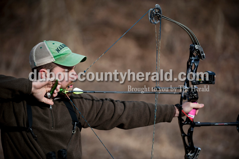 Carolyn Van Houten/The Herald<br /> Nick Meeks of Vincennes pulled back on his bow and aimed at a deer-shaped target during the 3rd annual 3D Archery Match at the St. Anthony Conservation Club on Saturday.  Shooters had to shoot 30 targets set out along the trails in order to compete for trophies.