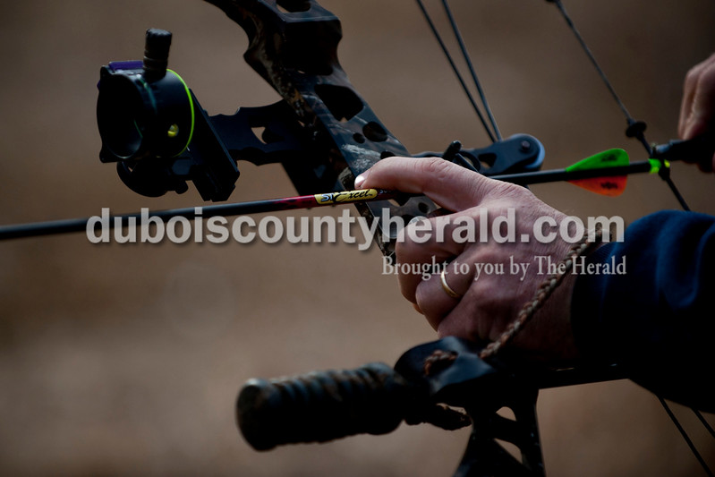 Carolyn Van Houten/The Herald<br /> Terry Niehaus of Huntingburg pulled back on his compound bow before aiming it at a target during the 3rd annual 3D Archery Match at the St. Anthony Conservation Club on Saturday.  Shooters had to shoot 30 targets set out along the trails in order to compete for trophies.