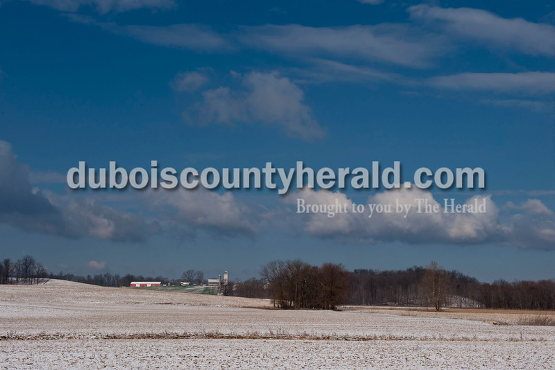 Carolyn Van Houten/The Herald<br /> Fallen snow blanketed the farmland along County Road 650W just outside of Jasper on Tuesday morning.