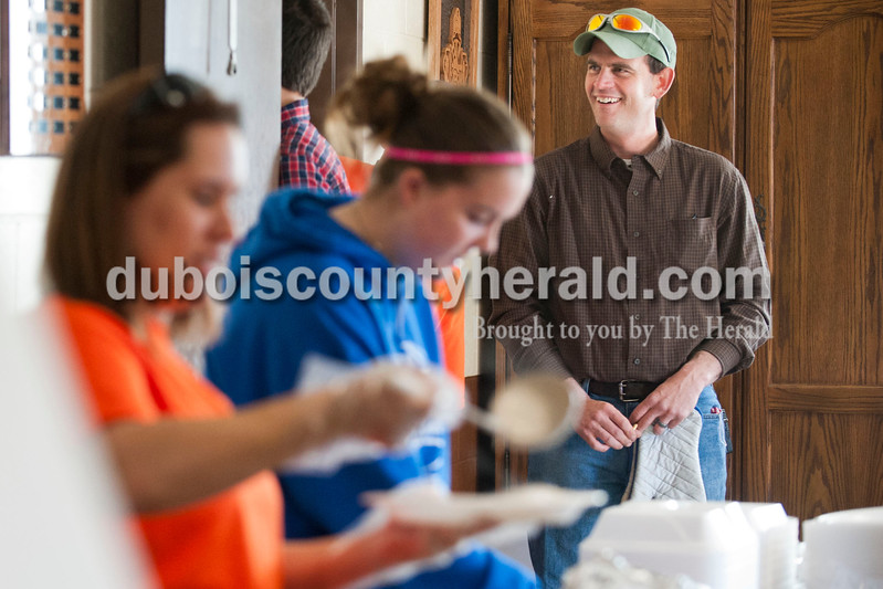 "Carolyn Van Houten/The Herald<br />  Firefighter Clint Eichmiller smiled while volunteers served food during the benefit breakfast for him and his family at the Dubois Volunteer Fire Department in Dubois on Sunday morning.  The Eichmillers lost their entire home and all of their possessions in a fire on February 28, 2014.  Over 400 people came to the benefit breakfast to support the family.  ""The turnout this morning is really overwhelming,"" Clint Eichmiller said."