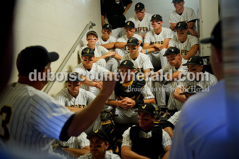 Matthew Busch/The Herald<br /> The Jasper team listened to head coach Terry Gobert behind the dugout before the start of the Class 3A baseball state championship game against Norwell at Victory Field in Indianapolis on Friday. The WIldcats lost 2-1.