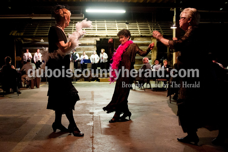"Carolyn Van Houten/The Herald<br /> Ruth Kuebler of Jasper, left, Deb Fuhs of Jasper, and Kathy Tretter of Ferdinand danced while the Recycled Teenagers played ""Shake, Rattle and Roll"" during the ""Party like it's 1929!"" event at the Dubois County Museum in Jasper on Saturday.  The evening event was themed around the prohibition days, featuring a moonshine demonstration, costume contest, and live music by the Recycled Teenagers."