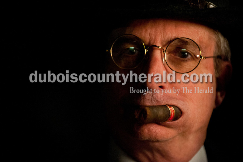 "Carolyn Van Houten/The Herald<br /> Gary Eck of Otwell held a cigar in his mouth after winning one of the ""Best Costume"" awards during the ""Party like it's 1929!"" event at the Dubois County Museum in Jasper on Saturday.  The evening event was themed around the prohibition days, featuring a moonshine demonstration, costume contest, and live music by the Recycled Teenagers."
